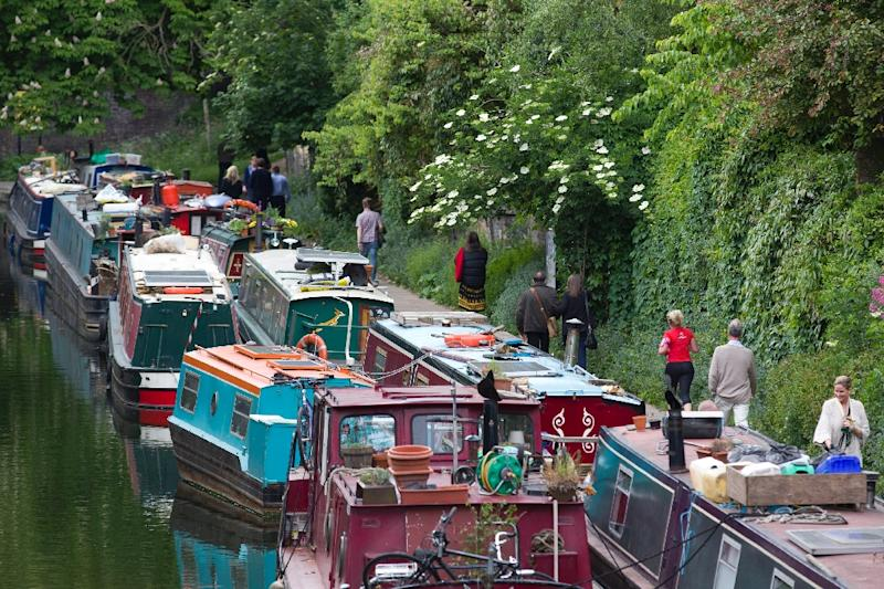 Canal boats, seen here on the Regents Canal in London, have become increasingly popular as housing costs have risen sharply in the UK capital (AFP Photo/Justin Tallis)