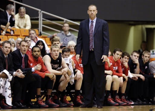 Utah head coach Larry Krystkowiak watches from the bench during the first half of an NCAA college basketball game against Oregon State in Corvallis, Ore., Wednesday, Feb. 6, 2013. (AP Photo/Don Ryan)