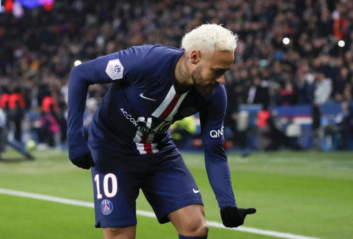 PSG's Neymar celebrates after scoring the opening goal during the French League One soccer match between Paris-Saint-Germain and Monaco at the Parc des Princes stadium in Paris, Sunday Jan. 12, 2020. (AP Photo/Francois Mori)