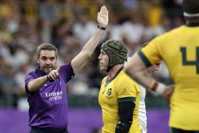 Referee Jerome Garces calls out a penalty during the Rugby World Cup quarterfinal match at Oita Stadium between England and Australia in Oita, Japan, Saturday, Oct. 19, 2019. (AP Photo/Aaron Favila)