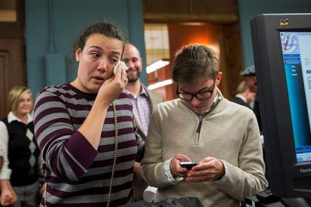 Lilly Leyh (L) and Sadie Pierce apply for a marriage license at City Hall in St. Louis, Missouri November 5, 2014.  REUTERS/Whitney Curtis