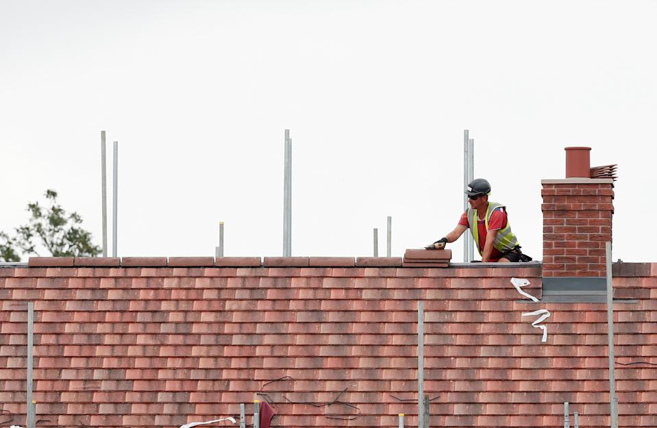 A construction worker builds a new house in Berkhamsted, Britain. Photo: Matthew Childs/Reuters