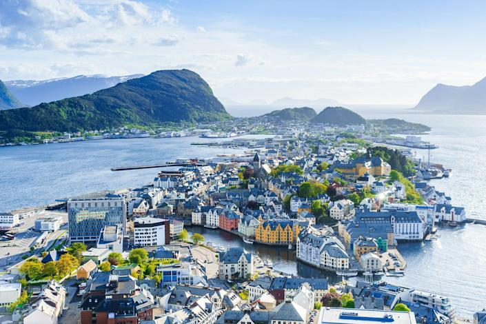 """<p>Famed as one of the most beautiful countries in the world, <a href=""""https://www.countryliving.com/uk/homes-interiors/property/a34458154/ulvsnes-island-for-sale-norway/"""" rel=""""nofollow noopener"""" target=""""_blank"""" data-ylk=""""slk:Norway"""" class=""""link rapid-noclick-resp"""">Norway</a> is bursting with striking landscapes and chic, Scandinavian style. </p><p>Its fjords, diverse adventures and dramatic beauty afford the <a href=""""https://www.countryliving.com/uk/travel-ideas/abroad/g30130329/holiday-destinations-europe/"""" rel=""""nofollow noopener"""" target=""""_blank"""" data-ylk=""""slk:European destination"""" class=""""link rapid-noclick-resp"""">European destination</a> a place on many bucket lists - and if you haven't explored Norway before, these beautiful photos will inspire you to visit.</p><p><a class=""""link rapid-noclick-resp"""" href=""""https://www.countrylivingholidays.com/search?locations%5Bsearch%5D=Norway&locations%5Bcountry%5D=NO"""" rel=""""nofollow noopener"""" target=""""_blank"""" data-ylk=""""slk:BROWSE HOLIDAYS TO NORWAY WITH CL"""">BROWSE HOLIDAYS TO NORWAY WITH CL</a></p><p>From its Northern Lights hotspots (Tromso, the North Cape and the Lofoten Islands), to its magnificent natural scenes (Eidfjord, Flamsdalen and Geirangerfjord), there's no shortage of breathtaking places to see in Norway. </p><p>We're so sure you'll fall in love with Norway after browsing these postcard-perfect photos that we've brought you four exclusive Country Living holidays to match.</p><p>If you post-pandemic plans involve riding on scenic trains, an epic three-week Arctic <a href=""""https://www.countrylivingholidays.com/tours/arctic-rail"""" rel=""""nofollow noopener"""" target=""""_blank"""" data-ylk=""""slk:rail escape taking in the amazing Flam Railway"""" class=""""link rapid-noclick-resp"""">rail escape taking in the amazing Flam Railway</a> could be for you. Or you could see Norway's beautiful <a href=""""https://www.countrylivingholidays.com/tours/norway-fjords-rail"""" rel=""""nofollow noopener"""" target=""""_blank"""" data-ylk=""""slk:fjords by rail and cruise over """