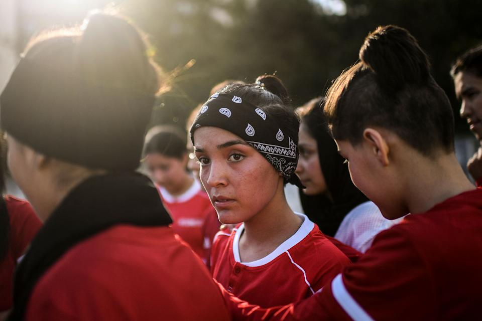 Players of Afghanistan national women football team attend to a training session at Odivelas, outskirts of Lisbon on September 30, 2021. - Forced to flee Afghanistan after the Taliban came to power, players of the women's national football team and their families were welcomed to Portugal where they were able to train again today in a suburban stadium of Lisbon. (Photo by PATRICIA DE MELO MOREIRA / AFP) (Photo by PATRICIA DE MELO MOREIRA/AFP via Getty Images)