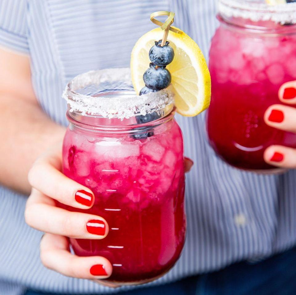 """<p>Turn your <a href=""""https://www.delish.com/uk/cocktails-drinks/a30893337/best-classic-margarita-recipe/"""" rel=""""nofollow noopener"""" target=""""_blank"""" data-ylk=""""slk:Margarita"""" class=""""link rapid-noclick-resp"""">Margarita</a> into summer goals with this blueberry lemonade version. It's just what you've been missing.</p><p>Get the <a href=""""https://www.delish.com/uk/cocktails-drinks/a33333336/blueberry-lemonade-margaritas-recipe/"""" rel=""""nofollow noopener"""" target=""""_blank"""" data-ylk=""""slk:Blueberry Lemonade Margaritas"""" class=""""link rapid-noclick-resp"""">Blueberry Lemonade Margaritas</a> recipe.</p>"""