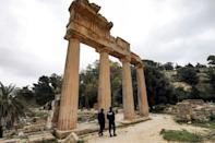 Local policemen patrol by a colonnade from the remnants of the Temple of Demeter in Cyrene
