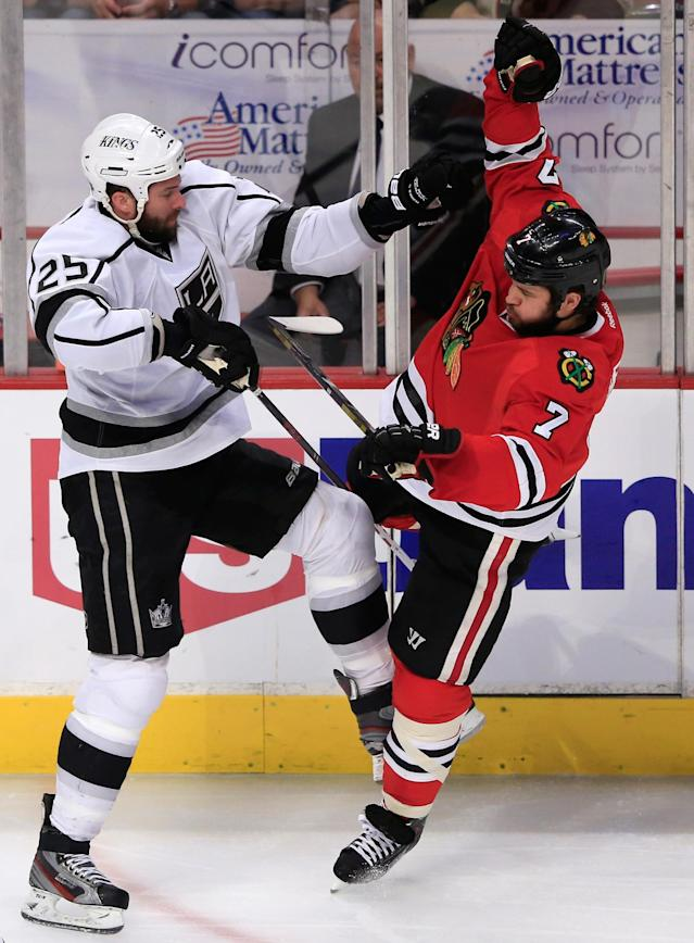 CHICAGO, IL - JUNE 01: Dustin Penner #25 of the Los Angeles Kings checks Brent Seabrook #7 of the Chicago Blackhawks near the side boards in the second period of Game One of the Western Conference Final during the 2013 NHL Stanley Cup Playoffs at United Center on June 1, 2013 in Chicago, Illinois. (Photo by Jamie Squire/Getty Images)
