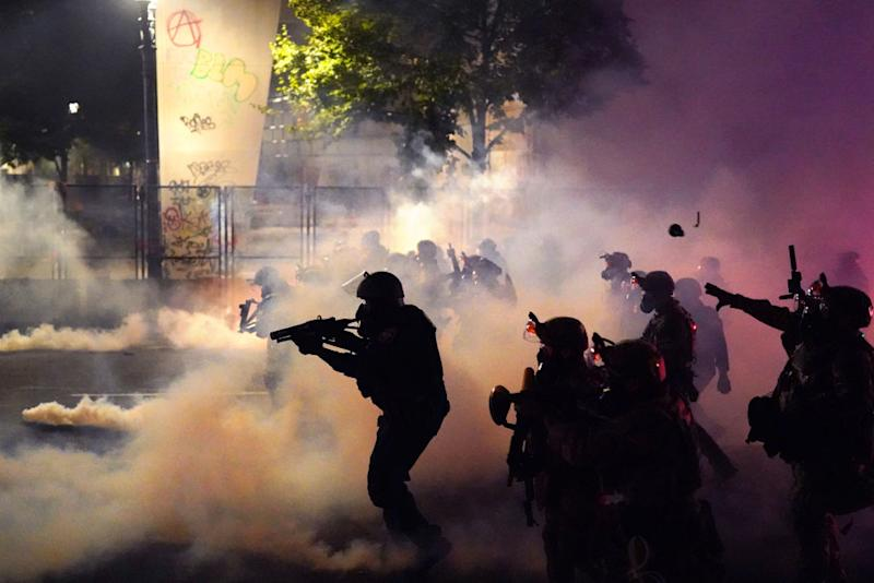 Federal officers deploy tear gas and less-lethal munitions in Portland on July 24. Source: Getty
