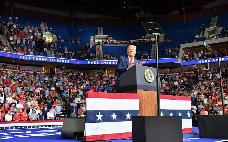 In this file photo taken on June 20, 2020, he upper section is seen partially empty as US President Donald Trump speaks during a campaign rally at the BOK Center in Tulsa, Oklahoma - Nicholas Kamm/AFP