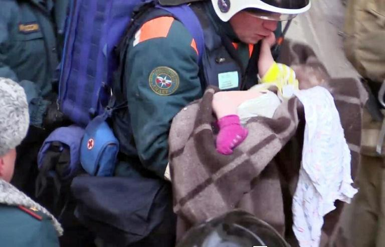 "Rescuers dug out a 10-month-old boy in what officials described as a ""New Year's miracle"" with 37 people confirmed dead from the apartment block blast"