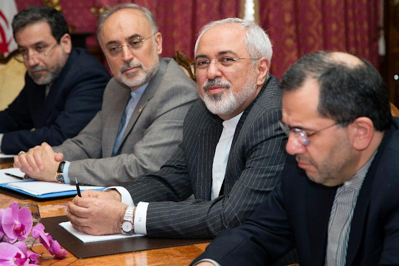 Iran's Foreign Minister Javad Zarif (2nd R) and with head of the Atomic Energy Organisation of Iran Ali Akbar Salehia (2nd L) sit at the negotiating table in Lausanne, Switzerland, on March 20, 2015 (AFP Photo/Brian Snyder)