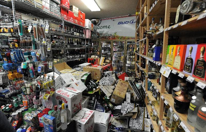 Bottles of liquor are strewn about inside Val's Liquor in downtown Napa, California after an earthquake struck the area on August 24, 2014 (AFP Photo/Josh Edelson)