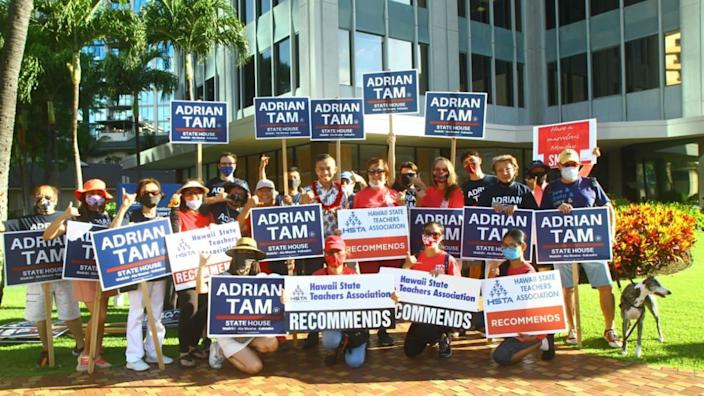 "<div class=""inline-image__caption""> <p>Tam supporters out campaigning.</p> </div> <div class=""inline-image__credit""> Courtesy Adrian Tam </div>"