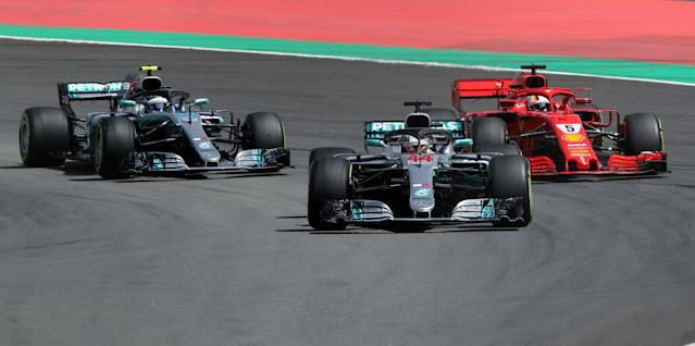 Formula One F1 - Spanish Grand Prix - Circuit de Barcelona-Catalunya, Barcelona, Spain - May 13, 2018 Mercedes' Lewis Hamilton leads Mercedes' Valtteri Bottas and Ferrari's Sebastian Vettel at the first corner during the race REUTERS/Albert Gea