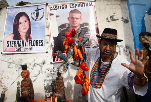 PHOTO: A shaman performs a ritual for the spiritual punishment of Joran van der Sloot, in poster top center, and for justice for Stephany Flores, in poster at left, in Lima, Peru, Jan. 6, 2012. (Karel Navarro/AP, FILE)