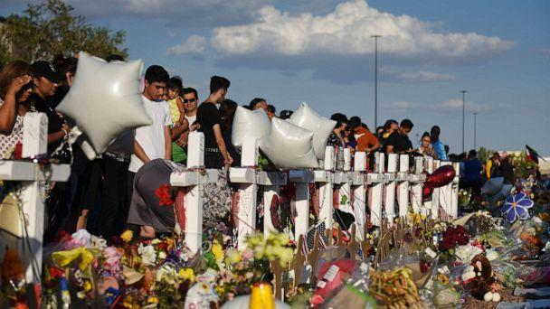 PHOTO: People gather to pay their respects at a growing memorial three days after a mass shooting at a Walmart store in El Paso, Texas, August 6, 2019 (Callaghan O'Hare/Reuters)