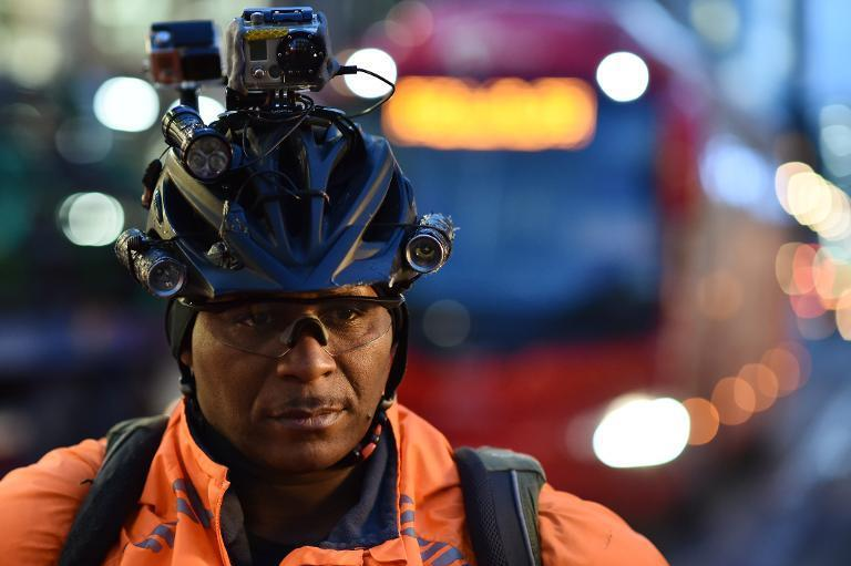 London cyclist Lewis Dediare, poses with his equipment on December 15, 2014, just one of dozens of British cyclists who have found a new raison d'etre: to travel the land recording reckless drivers and passing the evidence on to police (AFP Photo/Leon Neal)