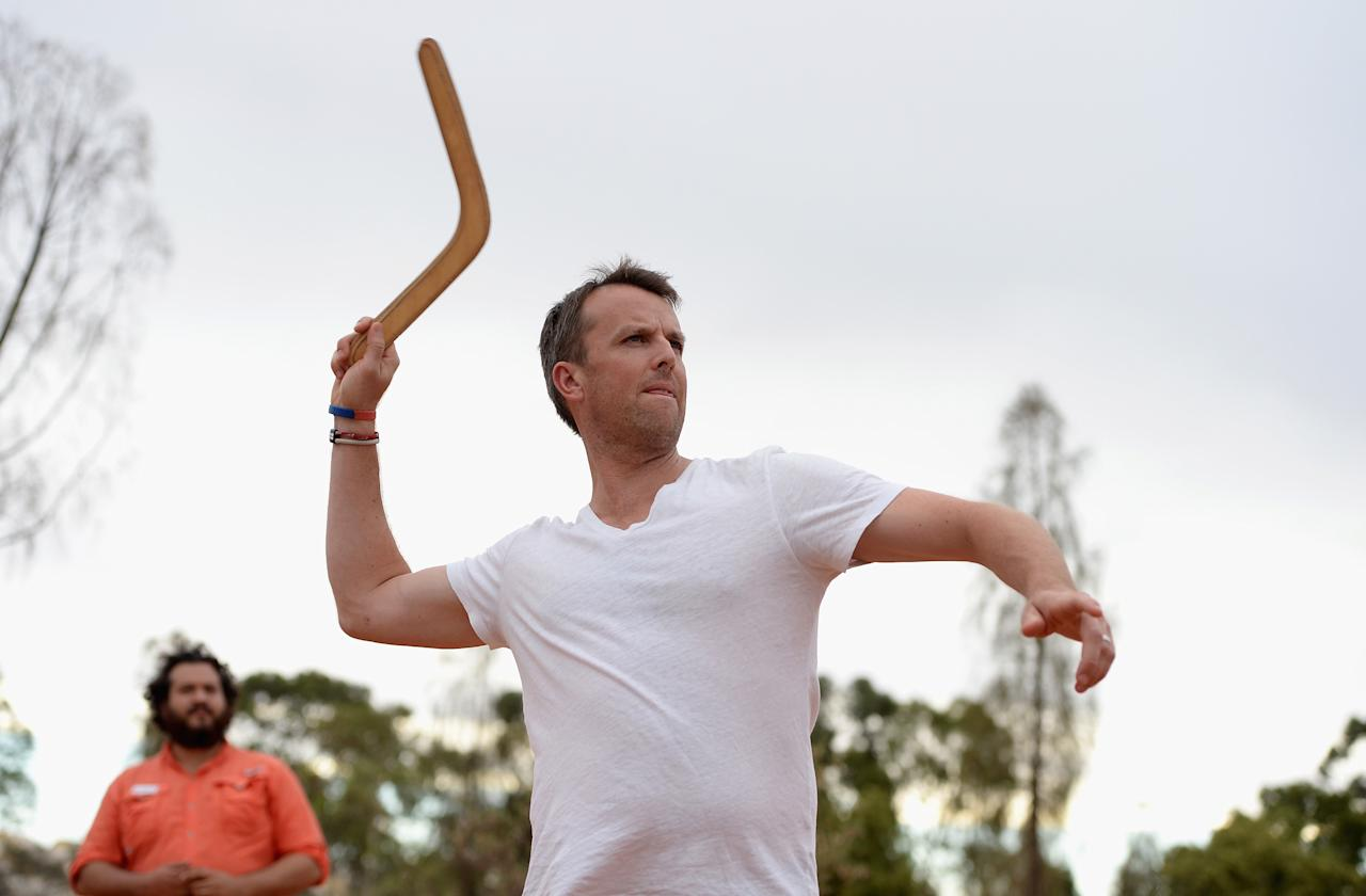 AYERS ROCK, AUSTRALIA - NOVEMBER 26:  Graeme Swann of England throws a boomerang during a team visit to Uluru, which is also known as Ayers Rock, on November 26, 2013 in Ayers Rock, Australia.  (Photo by Gareth Copley/Getty Images)