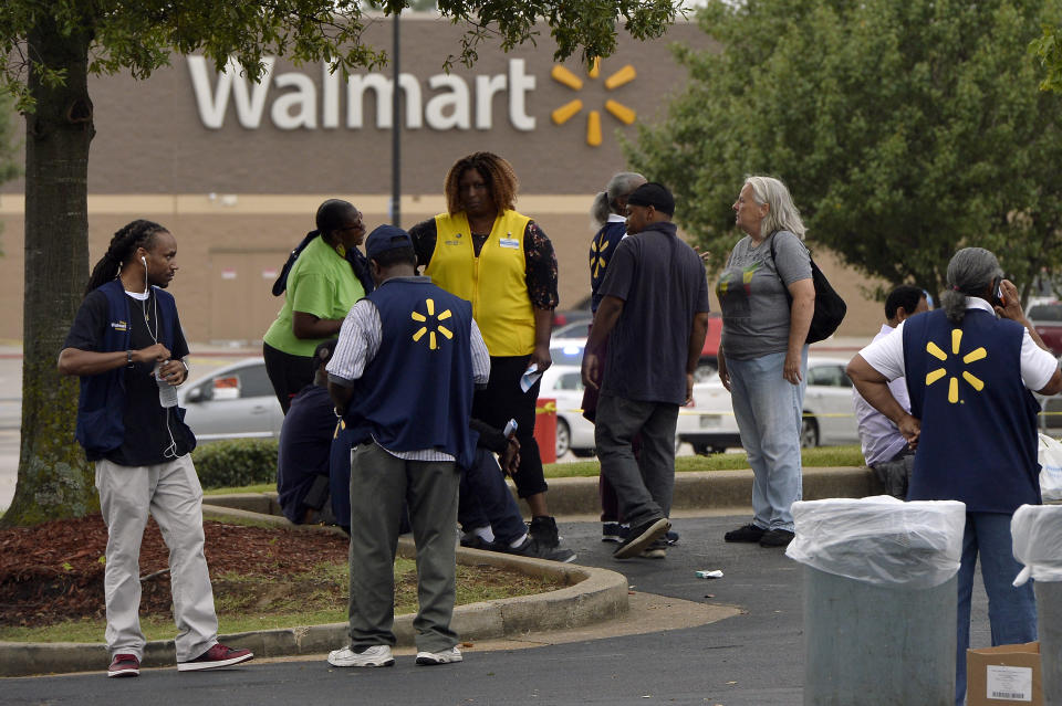 Employees gather in a nearby parking lot after a shooting at a Walmart store Tuesday, July 30, 2019 in Southaven, Miss. (AP Photo/Brandon Dill)