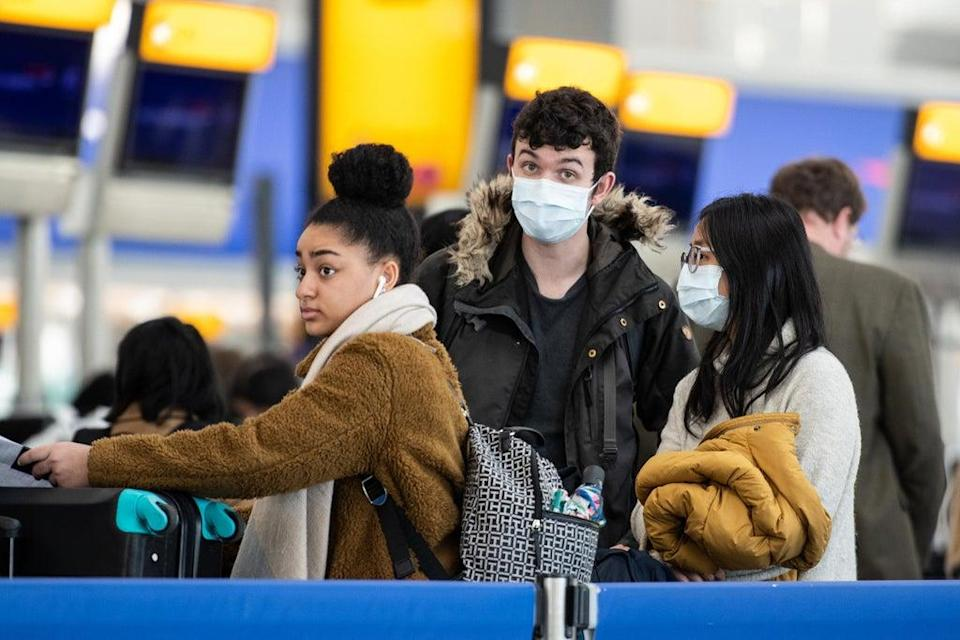 Passengers at Heathrow Airport, London, in March 2020 ((Photo by Leon Neal/Getty Images))