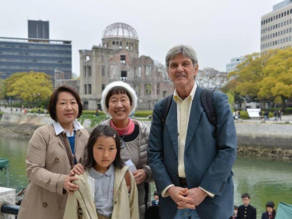 """Toshiko Tanaka, center, her daughter, Reiko, her granddaughter, Eri, and Steven Leeper, a peace activist, stand in front of the atomic bomb dome in Hiroshima. In 2014, Toshiko made a speech advocating for an end to nuclear weapons worldwide. <span class=""""copyright"""">Photo: Courtesy of Toshiko Tanaka.</span>"""
