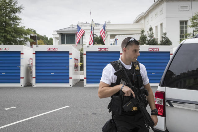 <p>With a Uniformed Secret Service officer standing watch, storage containers line the driveway as the West Wing of the White House in Washington, Friday, Aug. 11, 2017, as it goes through renovations while President Donald Trump is spending time at his golf resort in New Jersey. (AP Photo/J. Scott Applewhite) </p>
