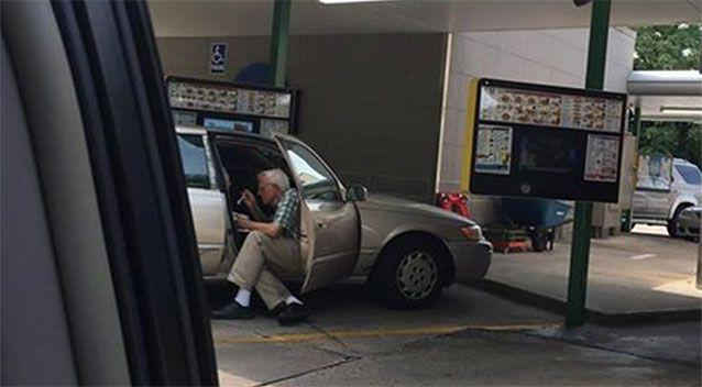 Sweet gesture: an elderly man was snapped spoon-feeding his wife ice cream in the afternoon heat. Picture: Brent Kelley/Facebook