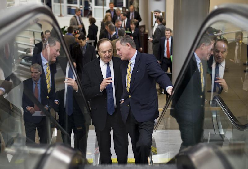Sen. Richard Burr, R-N.C., right, talks with Sen. Richard Shelby, R-Ala., left, as they ride an escalator on Capitol Hill in Washington, Friday, March 22, 2013, as lawmakers rush to the Senate floor to vote on amendments to the budget resolution. (AP Photo/J. Scott Applewhite)