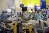 Critical Care staff take care of COVID-19 patients on the Christine Brown ward at King's College Hospital in London, Wednesday, Jan. 27, 2021. (AP Photo/Kirsty Wigglesworth, pool)