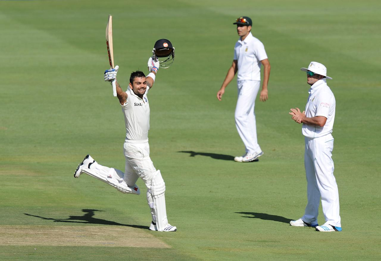 India's batsman Virat Khohli celebrates his century on the first day of the first cricket Test between South-Africa and India at the Wanderers Stadium in Johannesburg on December 18, 2013.           AFP PHOTO