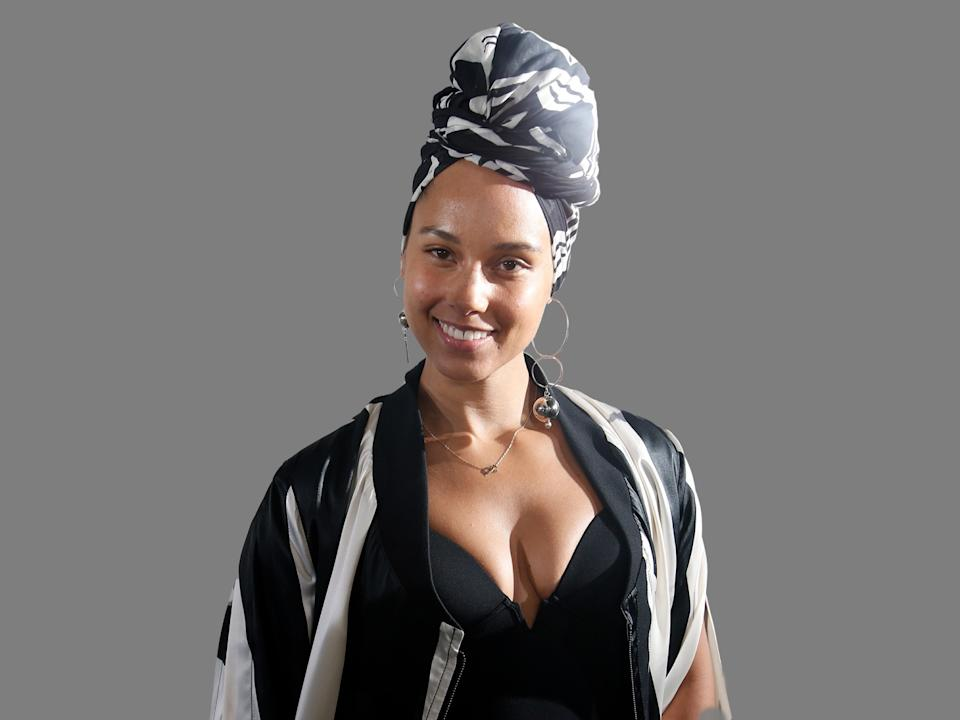 Alicia Keys headshot, as singer, graphic element on gray