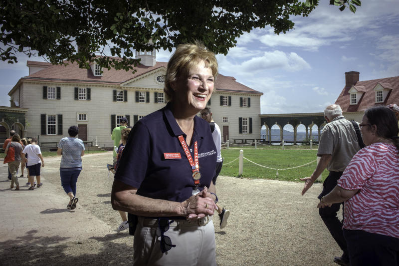 Marianne Ketels greets visitors at George Washington's Mount Vernon, America's first president's home in Alexandria, Virginia.