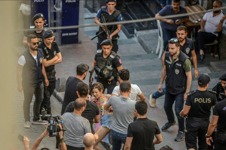 TTurkish police on Sunday fired tear gas at gay rights groups and activists who defied authorities to march for the Istanbul pride parade, banned for the fifth year in a row. (AFP Photo/TUBA KARA)