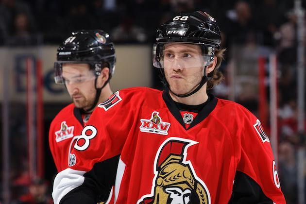 """OTTAWA, ON – APRIL 12: Team mates <a class=""""link rapid-noclick-resp"""" href=""""/nhl/players/4805/"""" data-ylk=""""slk:Mike Hoffman"""">Mike Hoffman</a> #68 and <a class=""""link rapid-noclick-resp"""" href=""""/nhl/players/5152/"""" data-ylk=""""slk:Mark Stone"""">Mark Stone</a> #61 of the <a class=""""link rapid-noclick-resp"""" href=""""/nhl/teams/ott/"""" data-ylk=""""slk:Ottawa Senators"""">Ottawa Senators</a> look on during a break against the <a class=""""link rapid-noclick-resp"""" href=""""/nhl/teams/bos/"""" data-ylk=""""slk:Boston Bruins"""">Boston Bruins</a> in Game One of the Eastern Conference First Round during the 2017 NHL Stanley Cup Playoffs at Canadian Tire Centre on April 12, 2017 in Ottawa, Ontario, Canada. (Photo by Jana Chytilova/Freestyle Photography/Getty Images) *** Local Caption ***"""