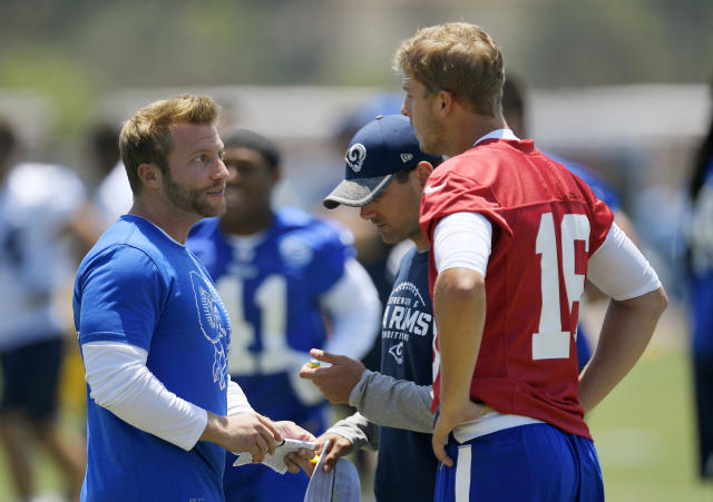 The Rams' Sean McVay, left, talks with quarterback Jared Goff, right, as offensive coordinator Matt LaFleur stands between them during a practice in 2017. (AP)