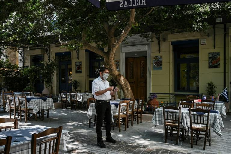 For the moment, only outdoor seating is permitted (AFP Photo/ARIS MESSINIS)