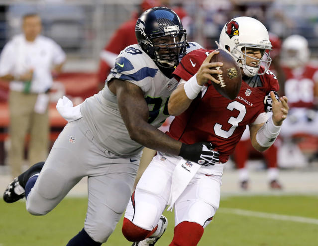 Arizona Cardinals quarterback Carson Palmer (3) is sacked by Seattle Seahawks defensive tackle Tony McDaniel (99) during the first half of an NFL football game, Thursday, Oct. 17, 2013, in Glendale, Ariz. (AP Photo/Ross D. Franklin)