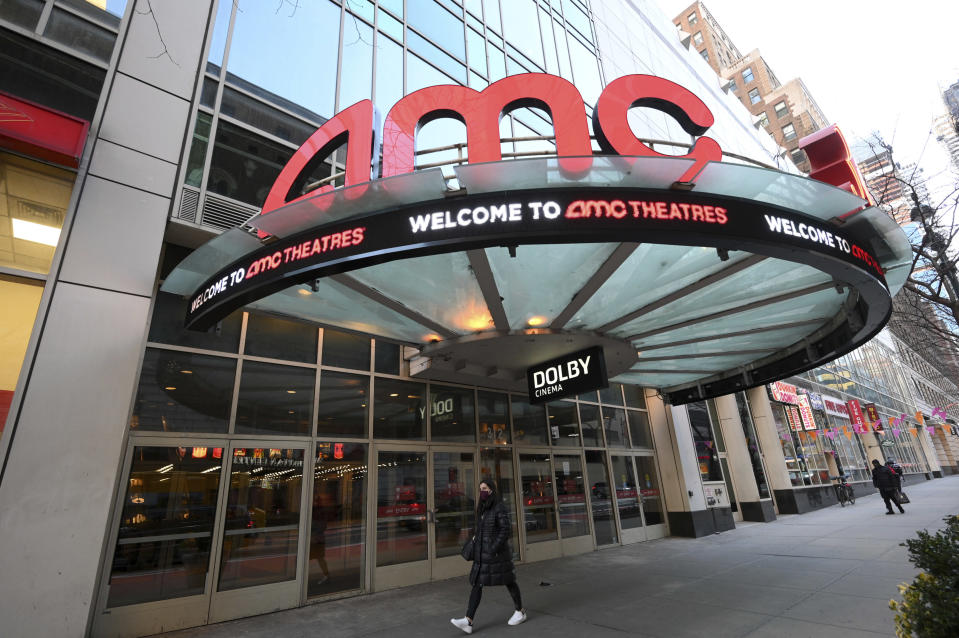 A pedestrian walks by the newly reopened AMC 34th Street theater on March 5, 2021, in New York. AMC Theatres says it will have 98% of its U.S. movie theaters open on Friday, with more expected to open by March 26. Shares of AMC Entertainment Holdings Inc. are up more than 4% before the market open on Thursday. (Photo by Evan Agostini/Invision/AP)