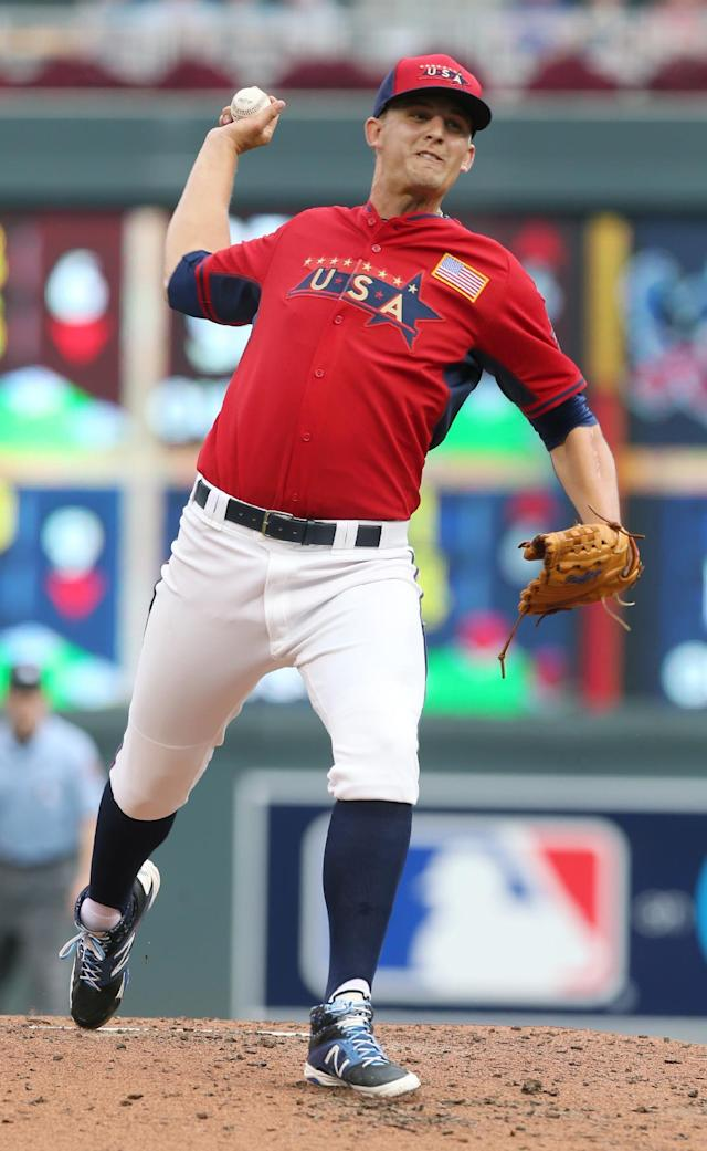 United States' pitcher Christian Binford throws a pitch during the third inning of the All-Star Futures baseball game against the World Team, Sunday, July 13, 2014, in Minneapolis. (AP Photo/Jim Mone)