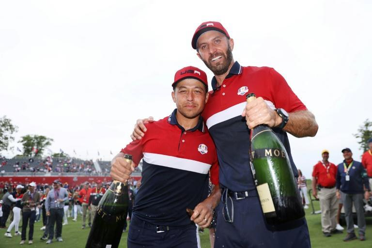 Winners: Dustin Johnson and Xander Schauffele celebrate the United States' 19-9 rout of Europe in the 143rd Ryder Cup (AFP/Warren Little)