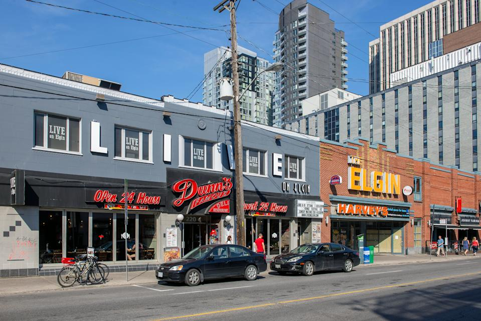 "Ottawa, Canada - June 11, 2017: Elgin Street including Dunn's famous smoked meat deli, Live on Elgin music venue, Harvey""u2019s in the old theatre formerly known as the The Elgin, and Johnny Farina's Italian restaurant"