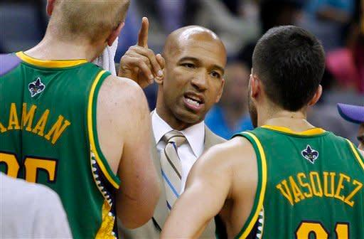 New Orleans Hornets head coach Monty Williams talks to point guard Greivis Vasquez (21) during a timeout in the second half of an NBA basketball game in New Orleans, Monday, Feb. 13, 2012. The Hornets won their fifth game this season 86-80.(AP Photo/Jonathan Bachman)