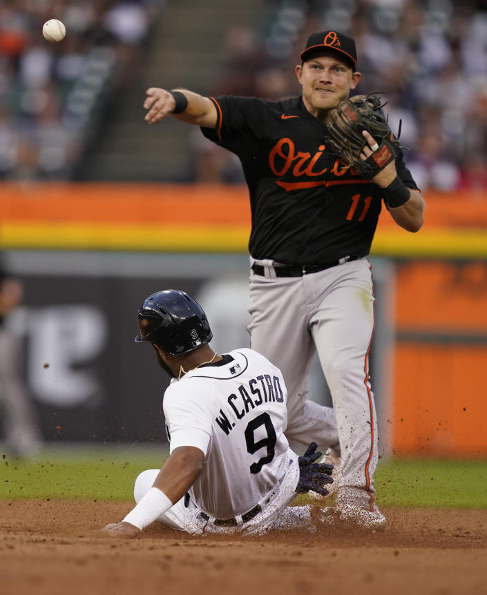 Detroit Tigers' Willi Castro is forced out at second as Baltimore Orioles second baseman Pat Valaika (11) throws to first to complete the double play hit into by Tigers' Derek Hill during the fifth inning of a baseball game, Friday, July 30, 2021, in Detroit. (AP Photo/Carlos Osorio)