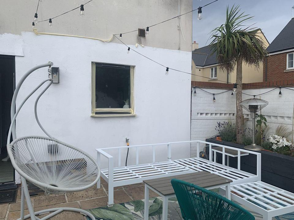 """<p>As the garden was coming together, Kel began to hang fairy lights and install a <a href=""""https://www.housebeautiful.com/uk/garden/g35548498/hanging-egg-chair/"""" rel=""""nofollow noopener"""" target=""""_blank"""" data-ylk=""""slk:swinging egg chair"""" class=""""link rapid-noclick-resp"""">swinging egg chair</a>. </p>"""
