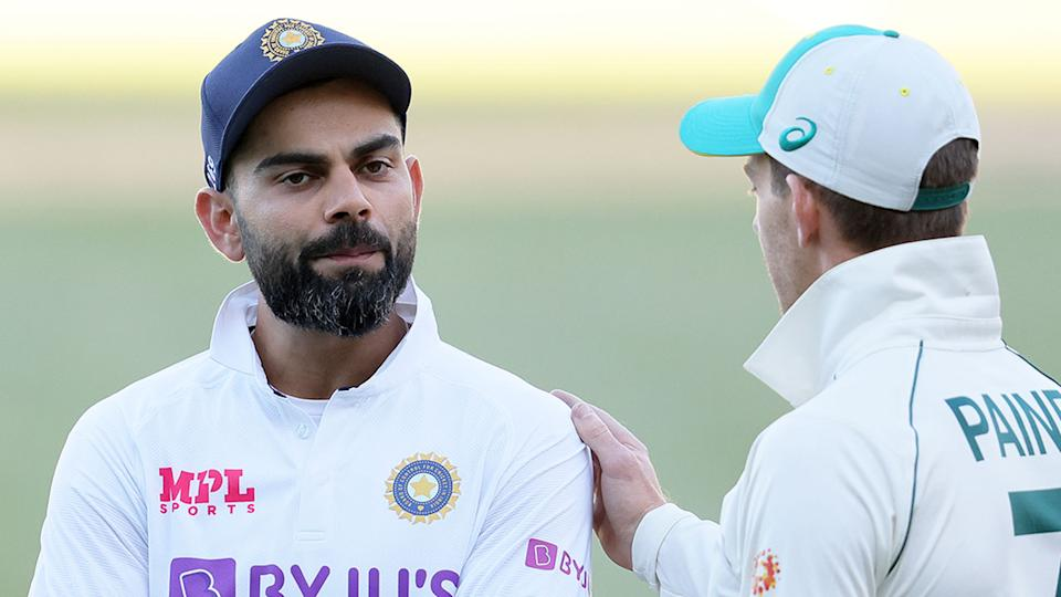 Pictured here, India captain Virat Kohli with Aussie counterpart Tim Paine.
