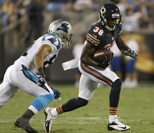 Chicago Bears' Zack Bowman (38) returns an interception against Carolina Panthers' Kealoha Pilares during the first half of a preseason NFL football game in Charlotte, N.C., Friday, Aug. 9, 2013. (AP Photo/Bob Leverone)