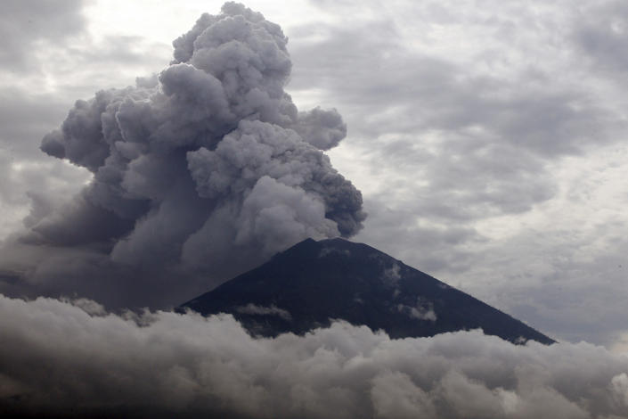 <p>Clouds of ashes rise from the Mount Agung volcano erupting in Karangasem, Bali, Indonesia, Nov. 28, 2017. Indonesia authorities raised the alert for the rumbling volcano to highest level on Monday and closed the international airport on the tourist island of Bali stranding thousands of travelers. (Photo: Firdia Lisnawati/AP) </p>