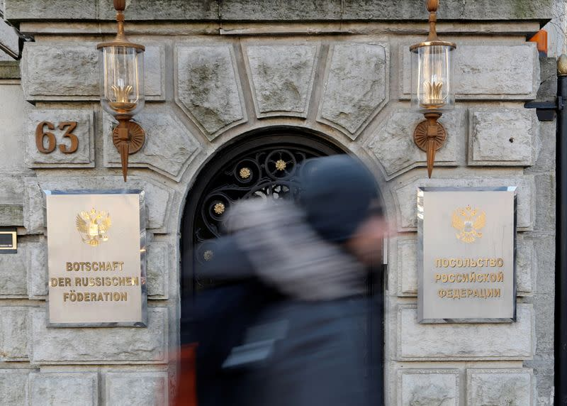 A man walks past the Russian embassy after Germany expelled two Russian diplomats in Berlin