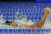 Michael Andrew participates in the men's 200 individual medley during wave 2 of the U.S. Olympic Swim Trials on Friday, June 18, 2021, in Omaha, Neb. (AP Photo/Jeff Roberson)