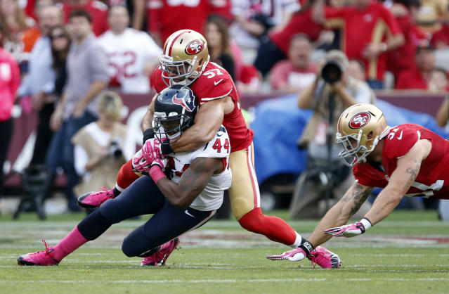 Houston Texans running back Ben Tate (44) is tackled by San Francisco 49ers linebacker Michael Wilhoite (57) as linebacker Dan Skuta moves in on the right, in the first half of an NFL football game in San Francisco, Sunday, Oct. 6, 2013. (AP Photo/Beck Diefenbach)